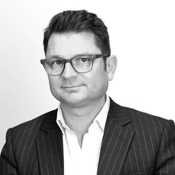 Black and white profile photo of Richard Draper, Managing Director at Rees Draper Wright